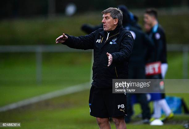 Newcastle's football development manager Peter Beardsley gestures from the sidelines in the rain during the Premier League 2 Match between Newcastle...