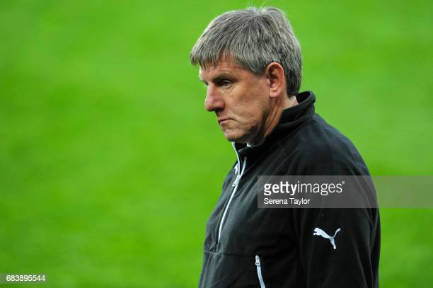 Newcastle's Football Development Manager Peter Beardsley stands on the pitch after West Ham win the Premier League 2 PlayOff Match between Newcastle...