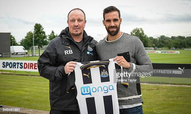Newcastle's fourth summer signing Jesus Gamez poses for photographs holding the 2016/17 Home Shirt with Newcastle's Manager Rafael Benitez at The...