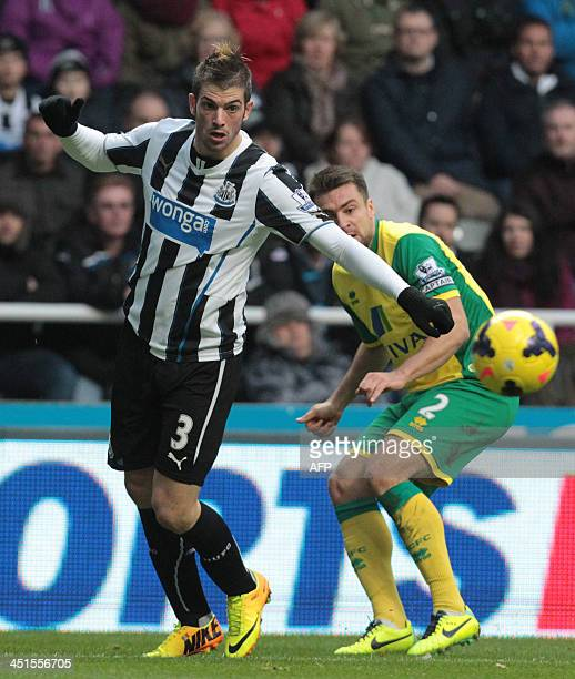 Newcastle's Italian defender Davide Santon blocks Norwich's EnglishBorn Scottish defender Russell Martin during the English Premier League football...