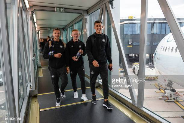 Newcastle's Jamie Sterry Matty Longstaff and Kelland Watts smiles as Newcastle depart for the Pre Season Tour to China for the Premier League Asia...
