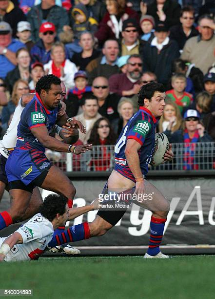 Newcastle's Jarrod Mullen has his pants pulled down by Melbourne's Billy Slater during the Round 19 NRL rugby league match between the Newcastle...