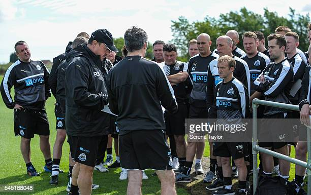 Newcastle's Manager Rafael Benitez talks to academy coaches during the Newcastle United Training session at The Newcastle United Training Centre on...
