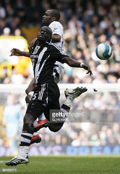 Newcastle's Midfielder Abdoulaye Faye Senegalese vies with Tottenham Hotspur's Brittish Striker Darren Bent during their Premier League match against...