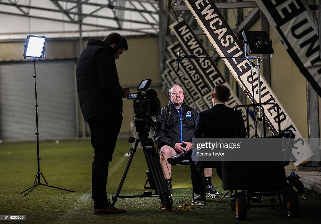 Newcastle's New Manager Rafael Benitez (C) is interviewed during the Newcastle United Training session at The Newcastle United Training Centre on March 11, 2016, in Newcastle upon Tyne, England.