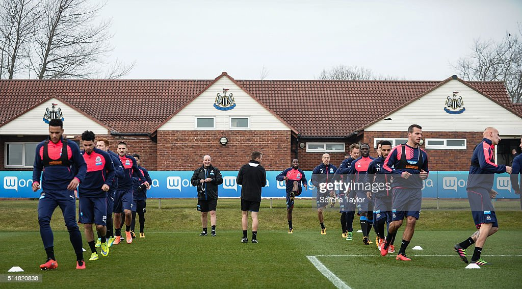 Newcastle's New Manager Rafael Benitez (C) stands on the pitch watching his new team warm up during the Newcastle United Training session at The Newcastle United Training Centre on March 11, 2016, in Newcastle upon Tyne, England.