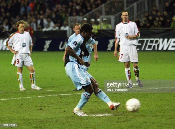 Newcastle's Obafemi Martins scores from the penalty spot during the UEFA Cup first knockout round first leg match between SV Zulte Waregem and...