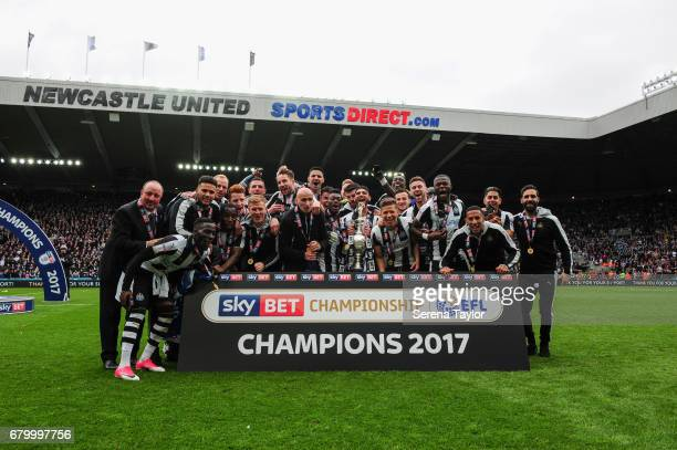 Newcastle's players and staff celebrate on the pitch after winning the championship league during the Sky Bet Championship Match between Newcastle...