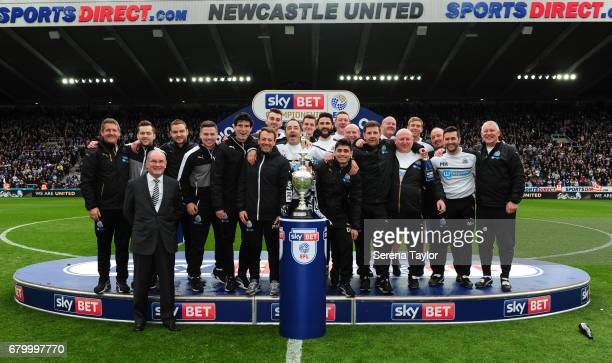 Newcastle's staff celebrate on the podium after winning the championship league during the Sky Bet Championship Match between Newcastle United and...