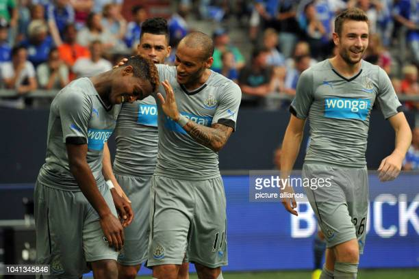 Newcastle's Yoan Gouffran congratulates Newcastle's Rolando Aarons to his 20 goal during the Schalke Cup test match between FC Schalke 04 and...