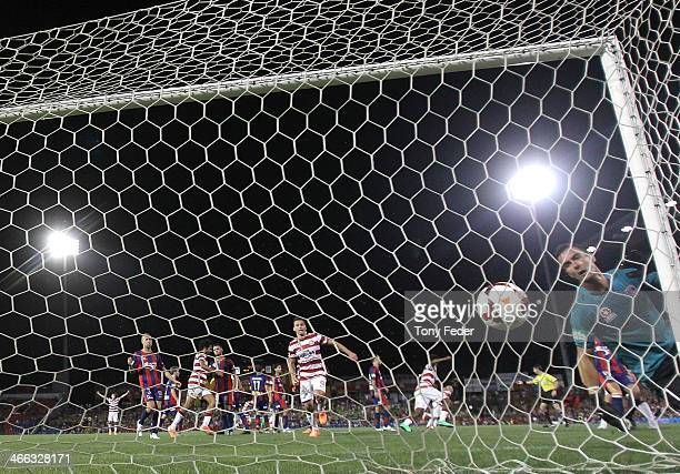 Newcatle Jets goalkeeper Mark Birighitti fails to stop the ball going into the net from a free kick during the round 17 A-League match between...