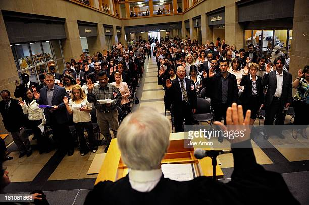 NEWCITIZENS09b Over one hundred new citizens from 33 different nations raised their right hands and were sworn in by Immigration Judge James P...