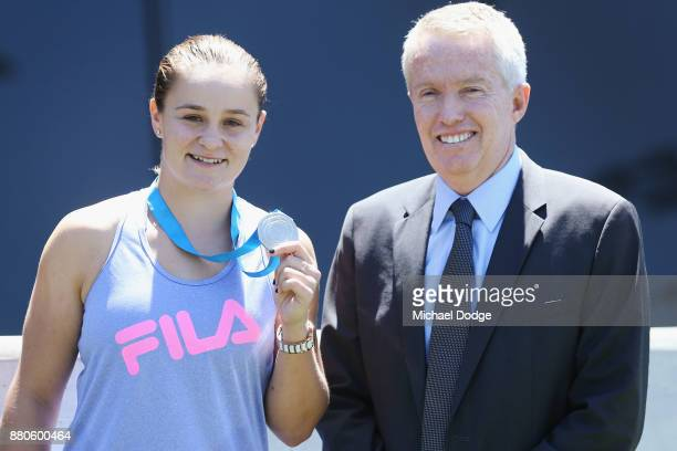 Newcombe Medallist Ashleigh Barty poses with Tennis Australia CEO Craig Tiley at Melbourne Park on November 28 2017 in Melbourne Australia Barty's...