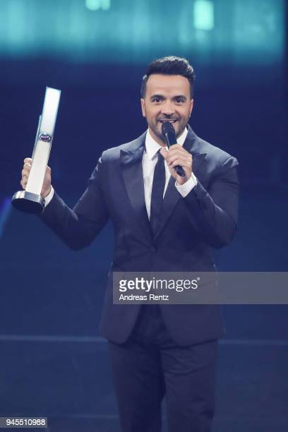 'Newcomer International' award winner Luis Fonsi speaks on stage during the Echo Award show at Messe Berlin on April 12 2018 in Berlin Germany