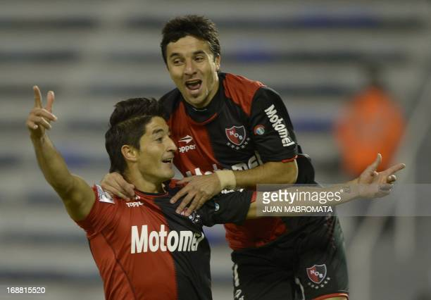 Newell's Old Boys' defender Milton Casco celebrates with teammate forward Ignacio Scocco after scoring against Velez Sarsfield during their Copa...