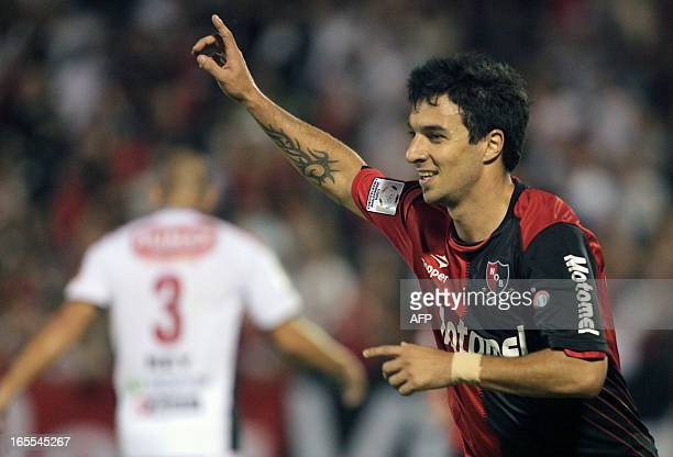 Newell's Old Boys' Ignacio Scocco celebrates after scoring the second goal against Deportivo Lara during their Libertadores Cup football match in...