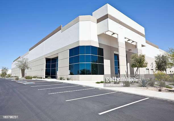 newer white office building from street view  - corner stock pictures, royalty-free photos & images