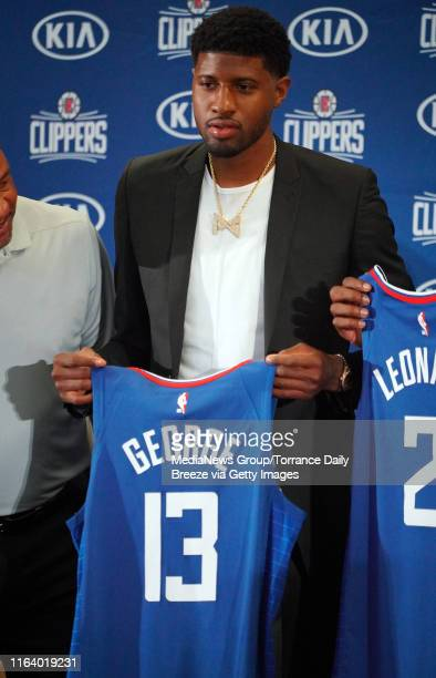 Newest Clippers player Paul George holds his jersey during a press conference at the Green Meadows Recreation Center in Los Angeles on Wednesday July...