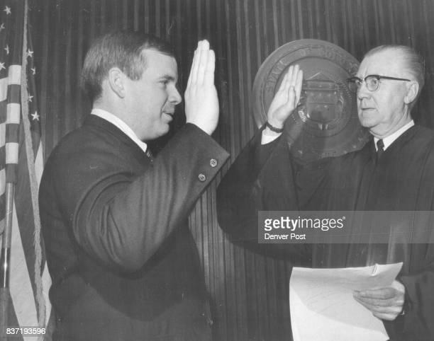 Newest Deputy DA Sworn in Robert J Conrad left was sworn in Friday as Denver deputy district attorney by Dist Judge Gerald E McAuliffe Conrad took...