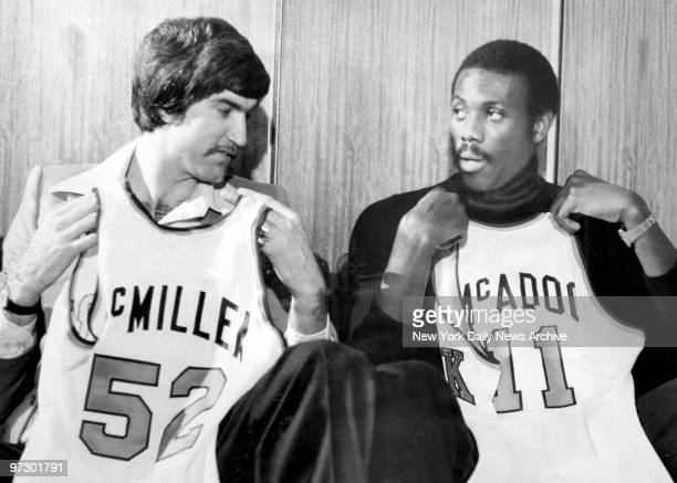 Newest Knicks Tom McMillen and Bob McAdoo obtained from Buffalo in $3 million deal display uniform numbers they'll waer