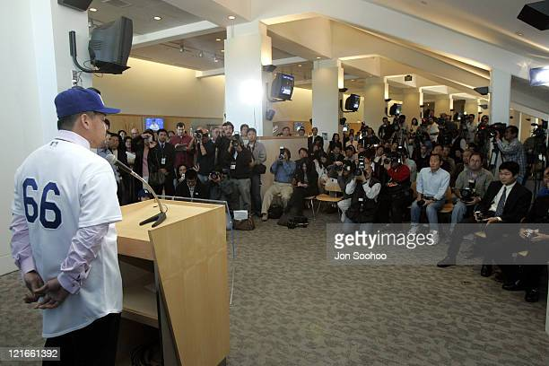 Newest Los Angeles Dodger Norihiro Nakamura speaks to the news media at Dodger Stadium in Los Angeles California on February 3 2005