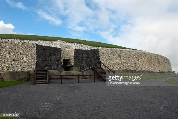 Newgrange a Neolithic or New Stone Age burial site in County Meath that contains the best known of the three great Irish passage tombs of the Bru Na...