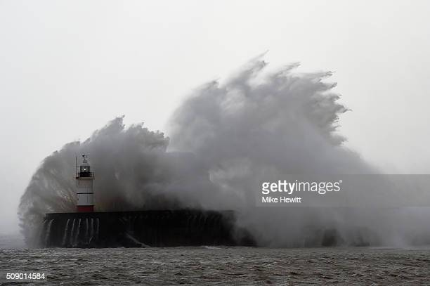 Newhaven Harbour wall and lighthouse take a battering on February 8, 2016 in Newhaven, East Sussex. Storm Imogen is the ninth named storm to hit the...