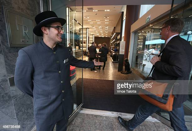 Newley opened Holt Renfrew for Mens shop comes with valet parking and a door man on the outside and inside has works of Canadian art for sale in...
