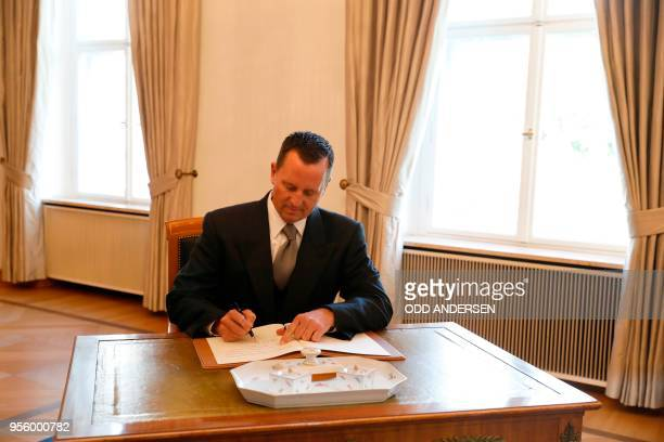 Newly accredited US Ambassador Richard Allen Grenell sign his letter of accreditation during a ceremony for new Ambassadors in Berlin Germany on May...