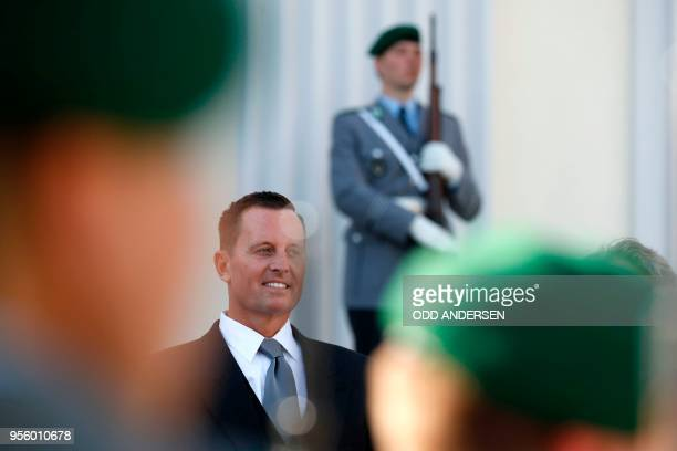 Newly accredited US Ambassador Richard Allen Grenell stands in front of a military honor guard during an accreditation ceremony for new Ambassadors...