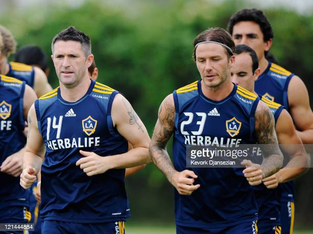 Newly acquired Los Angeles Galaxy forward Robbie Keane and David Beckham during training at The Home Depot Center on August 19 2011 in Carson...