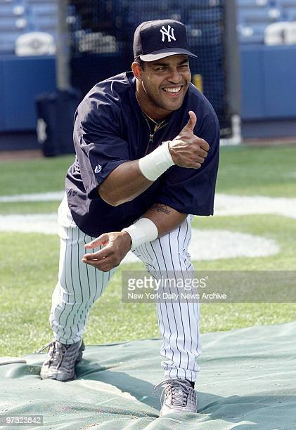 Newly acquired outfielder Raul Mondesi gives his thumbsup to being dealt to the New York Yankees from Toronto prior to a game against Cleveland...