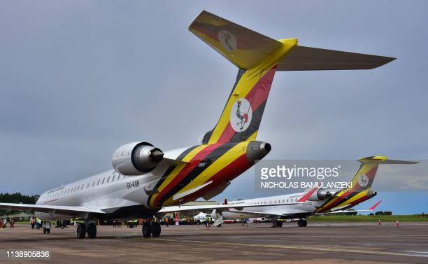 Newly acquired Uganda Airlines Bombardier CRJ900 aircraft stand on the runway at Entebbe Airport on the outskirts of Kampala on April 23 2019 The...