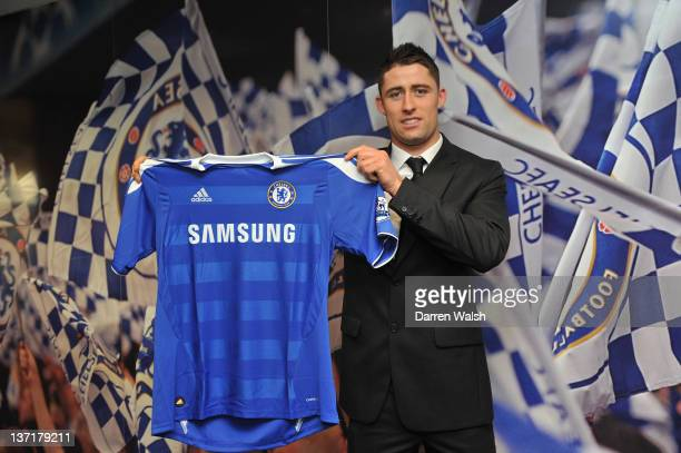 Newly announced Chelsea FC signing Gary Cahill holds up his new shirt at Stamford Bridge on January 16 2012 in London England