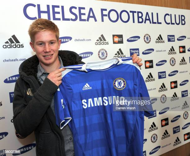 Newly announced Chelsea FC signing Kevin De Bruyne holds up his new shirt at the Cobham Training ground on January 31 2012 in Cobham England