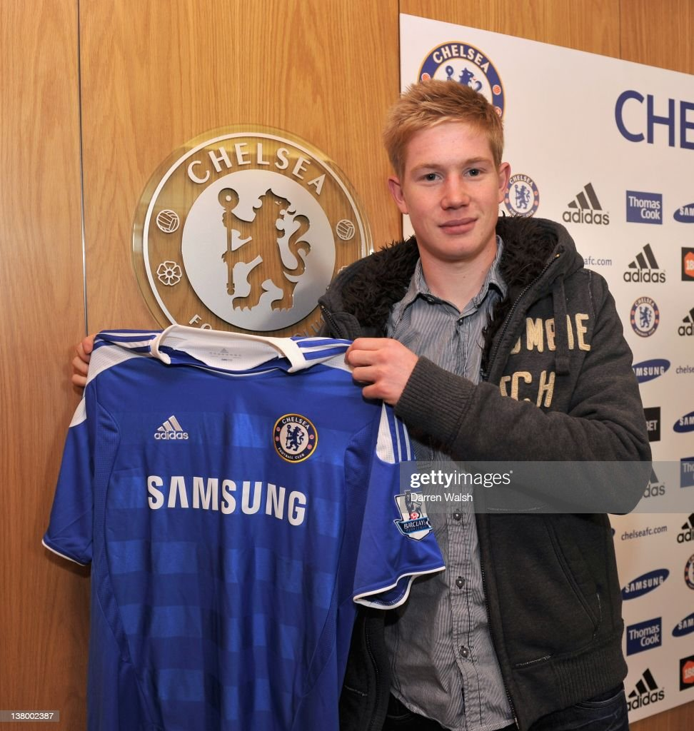 Newly announced Chelsea FC signing Kevin De Bruyne holds up his new shirt at the Cobham Training ground on January 31, 2012 in Cobham, England.