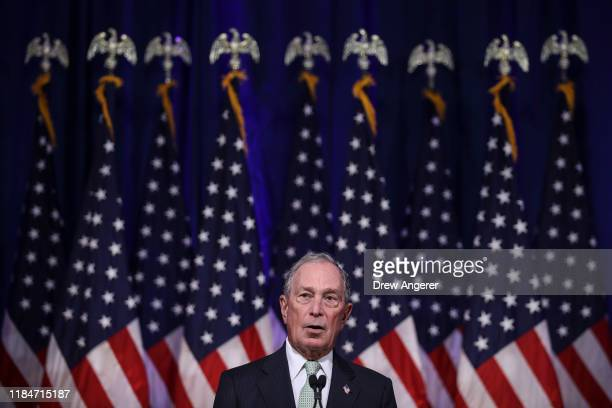 Newly announced Democratic presidential candidate, former New York Mayor Michael Bloomberg speaks during a press conference to discuss his...