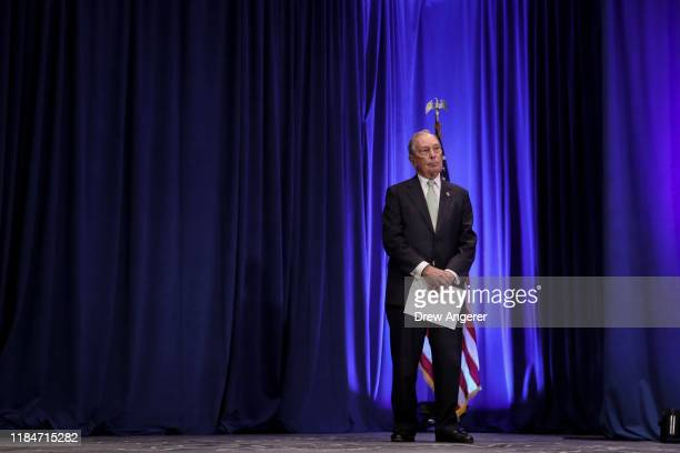 Newly announced Democratic presidential candidate, former New York Mayor Michael Bloomberg prepares for a press conference to discuss his...