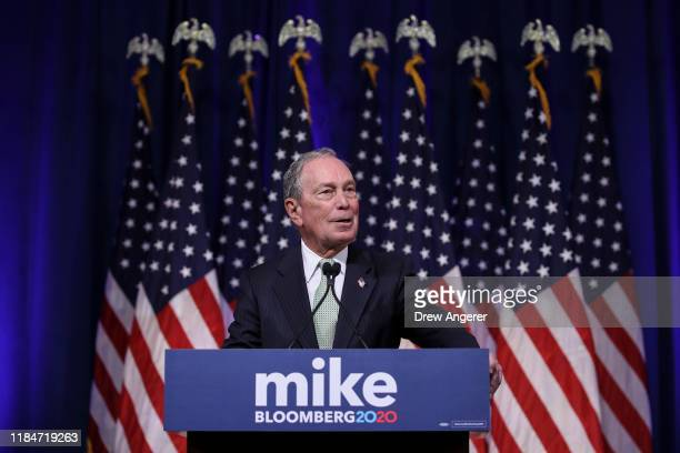 Newly announced Democratic presidential candidate former New York Mayor Michael Bloomberg speaks at a press conference to discuss his presidential...