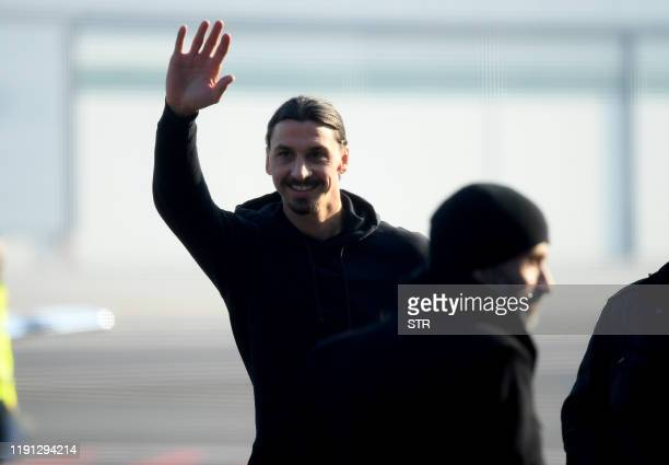Newly appointed AC Milan forward Zlatan Ibrahimovic waves upon his arrival at Linate airport on January 2 2020 Ibrahimovic has signed with AC Milan...