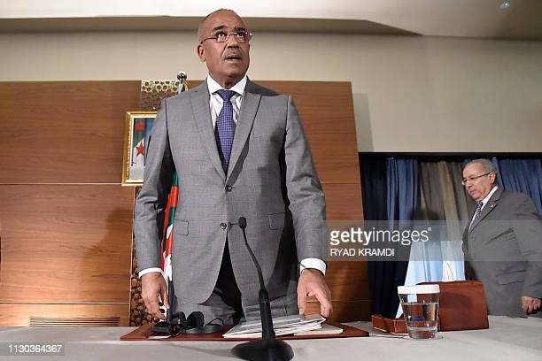 Newly appointed Algeria's prime minister Noureddine Bedoui arrives for a press conference with his deputy Ramtane Lamamra in Algiers on March 14 2019...