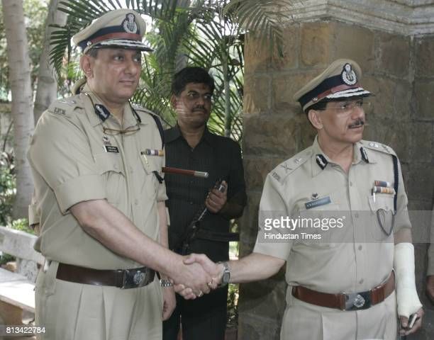 Newly Appointed ATS chief Rakesh Maria shakes hand with Ex ATS chief K.P. Raghuvanshi in Mumbai on Monday.