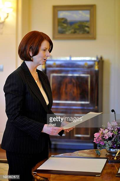 Newly appointed Australian Prime Minister Julia Gillard is sworn in by Governor General Quentin Bryce during a swearing in ceremony at Government...