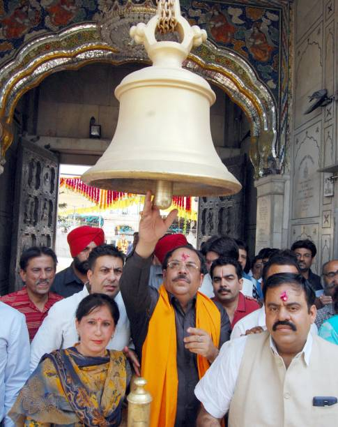 Newly appointed Bharatiya Janata Party Punjab president and Rajya Sabha MP Shwait Malik ring bell during a visit at Durgiana Temple on his arrival on.
