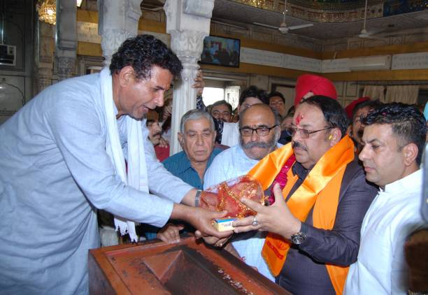 Newly appointed Bharatiya Janata Party Punjab president and Rajya Sabha MP Shwait Malik pays obeisance at Durgiana Temple on April 6 2018 in Amritsar.