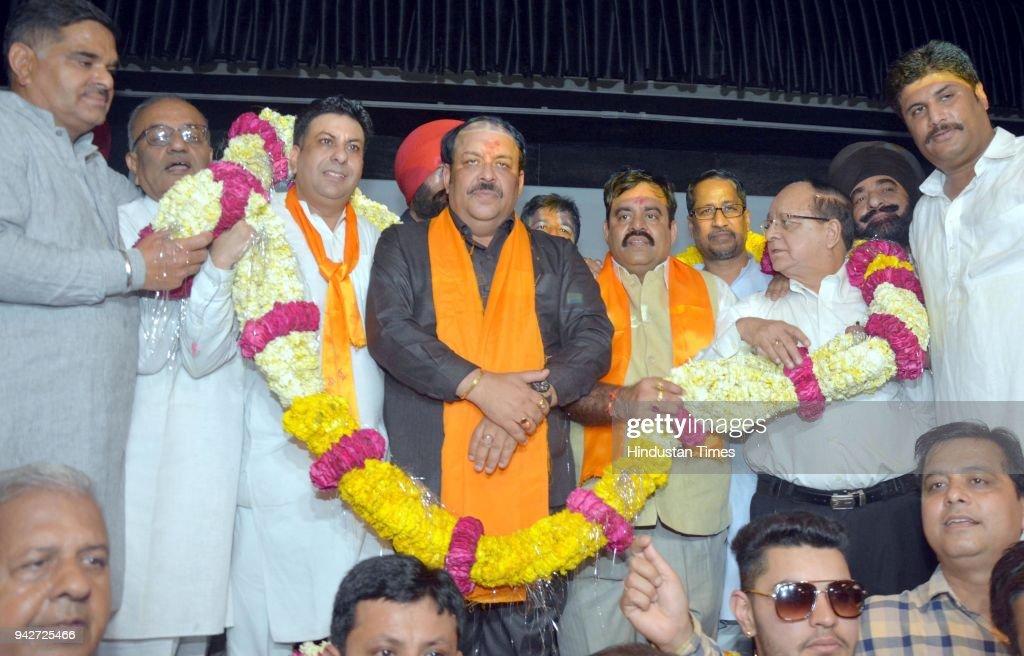 Newly appointed Bharatiya Janata Party Punjab president and Rajya Sabha MP Shwait Malik being garlanded by the district president Rajesh Honey BJP...