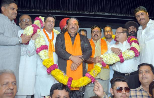 Newly appointed Bharatiya Janata Party Punjab president and Rajya Sabha MP Shwait Malik being garlanded by the district president Rajesh Honey BJP...