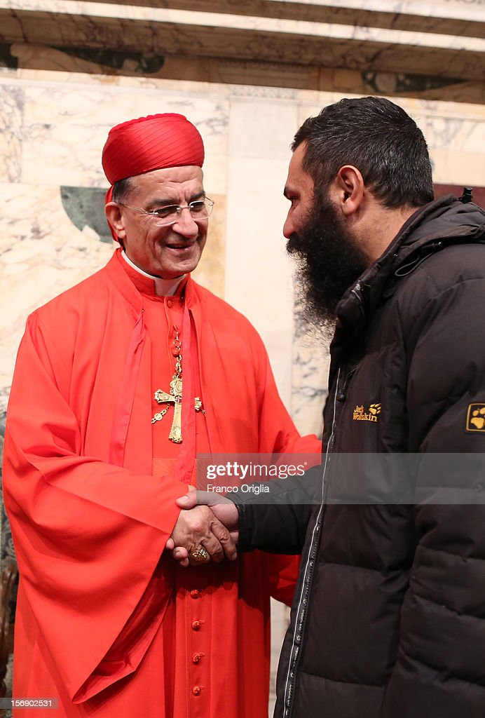 Newly appointed cardinal Bechara Boutros Rai (L),patriarch of Antiochia receives congratulations during the courtesy visits at the Sala del Trono Hall at the end of the concistory held by Pope Benedict XVI on November 24, 2012 in Vatican City, Vatican. The Pontiff installed 6 new cardinals during the ceremony, who will be responsible for choosing his successor.