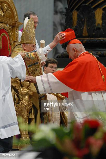 US newly appointed cardinal John Patrick Foley gets his biretta square red hat symbolising the blood of the martyrs from Pope Benedict XVI in St...