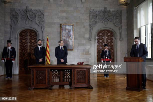 Newly appointed Catalan president Quim Torra and Catalan parliament speaker Roger Torrent listen to an introduction by Catalan government secretary...